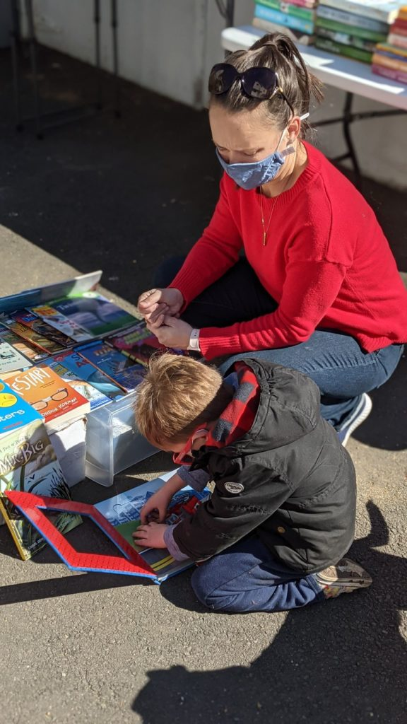 Mother and Son Looking at Books